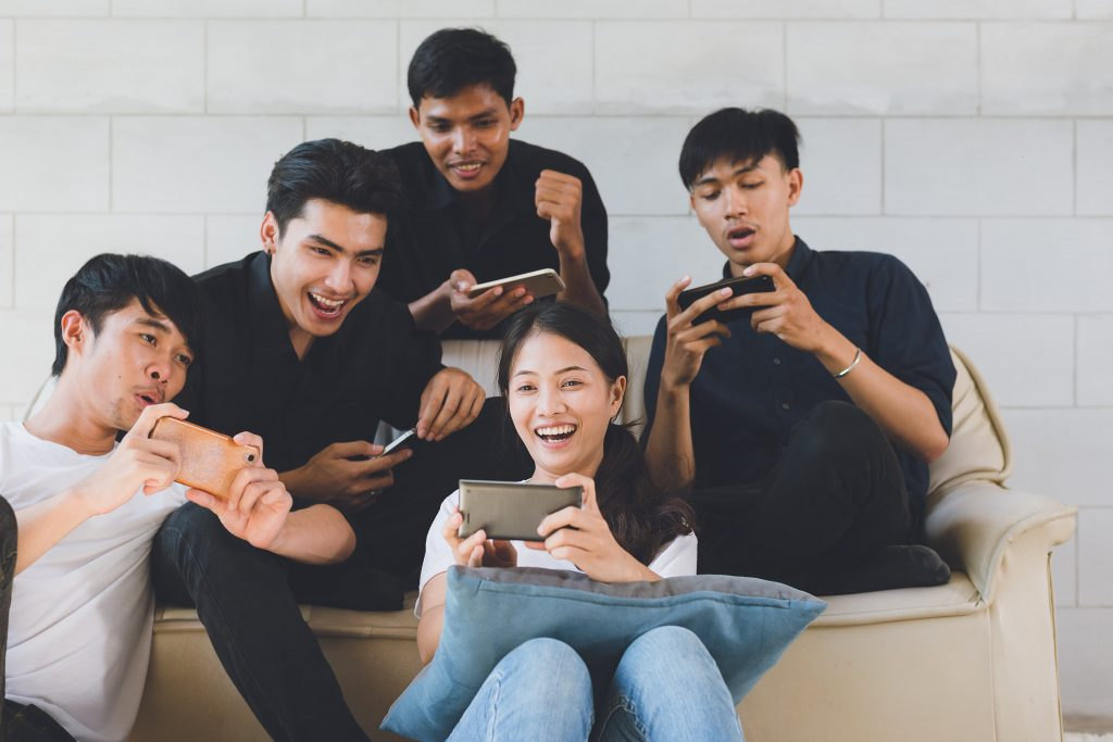 group of people using their phones together