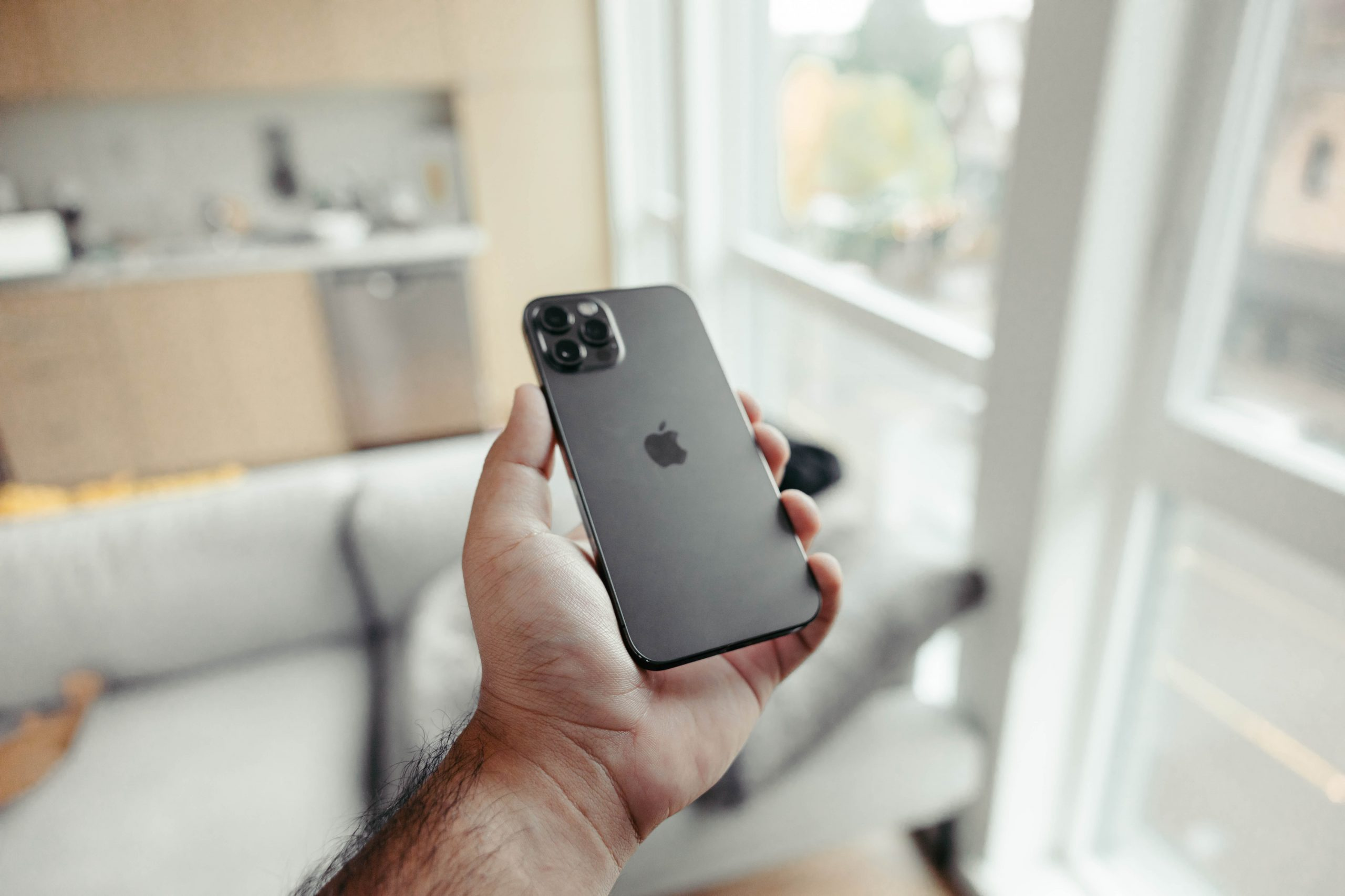 person holding a black iphone