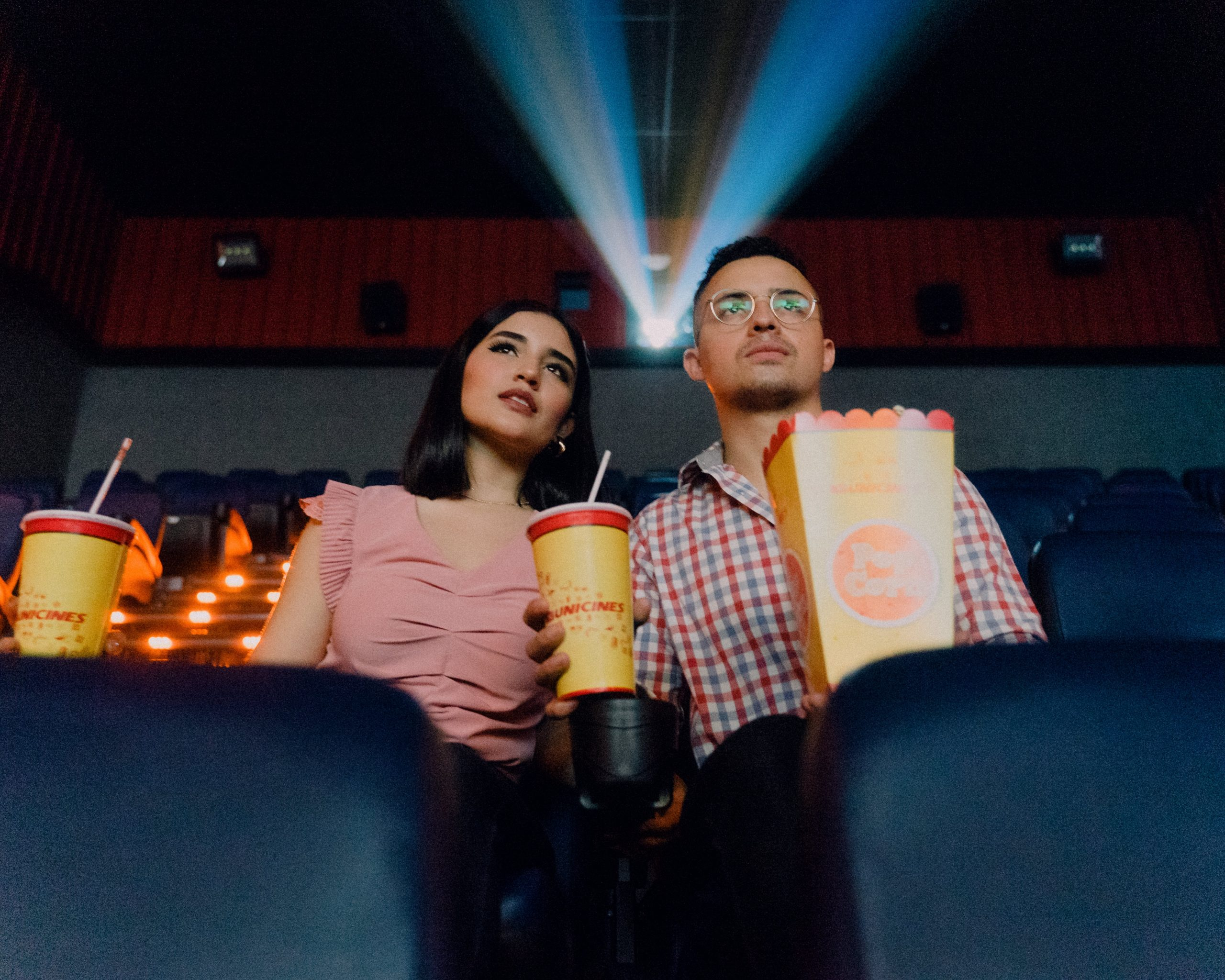 couple watching a movie at a theatre