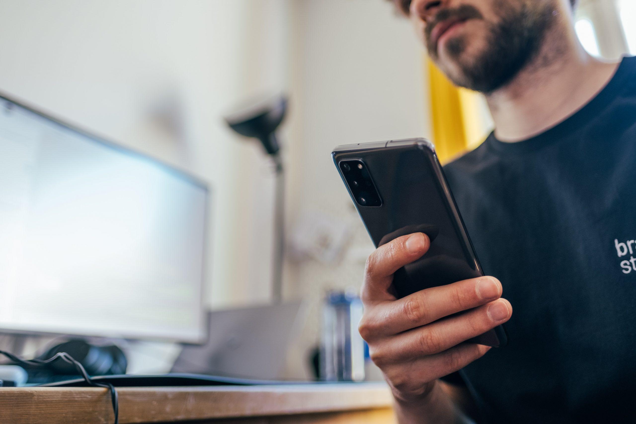 man holding a samsung phone