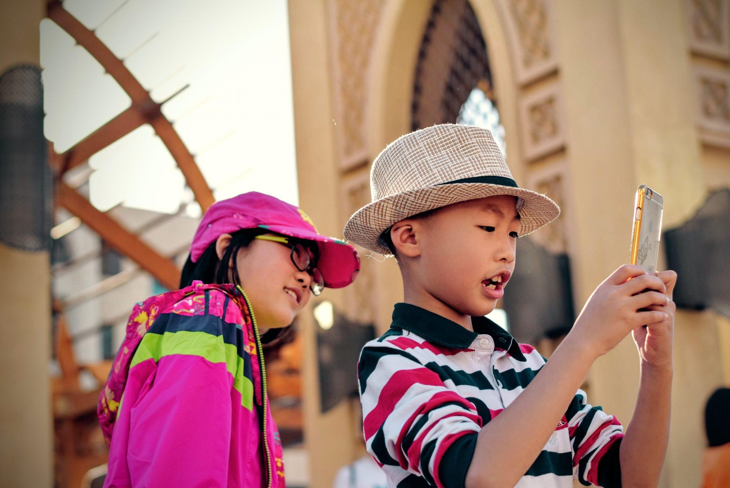 2 children using a phone